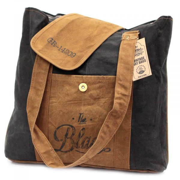 Vintage bag with stylish black cotton and brown suede style.